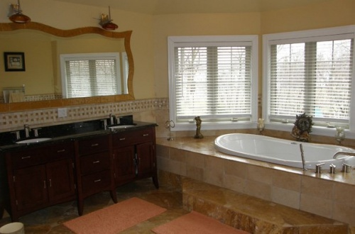 j_Master bath has jacuzzi tub, dual vanity, and seperate large shower with body sprays