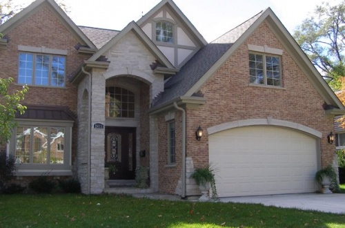 a_Stunning two story Colonial with brick and stone accents and a 2.5 car garage