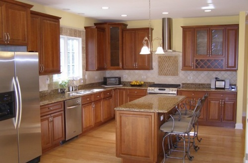 d_Spectacular kitchen with full stainless steel appliance package and island with breakfast bar overhang
