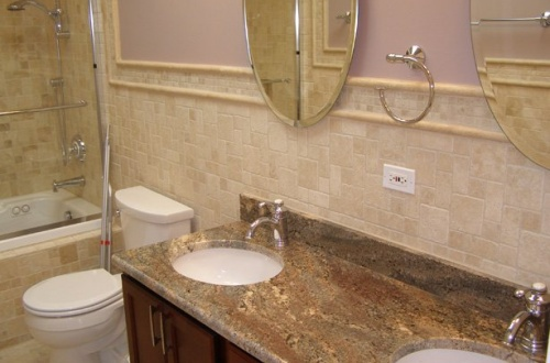 m_Hall bath with double sink and shower with jacuzzi tub