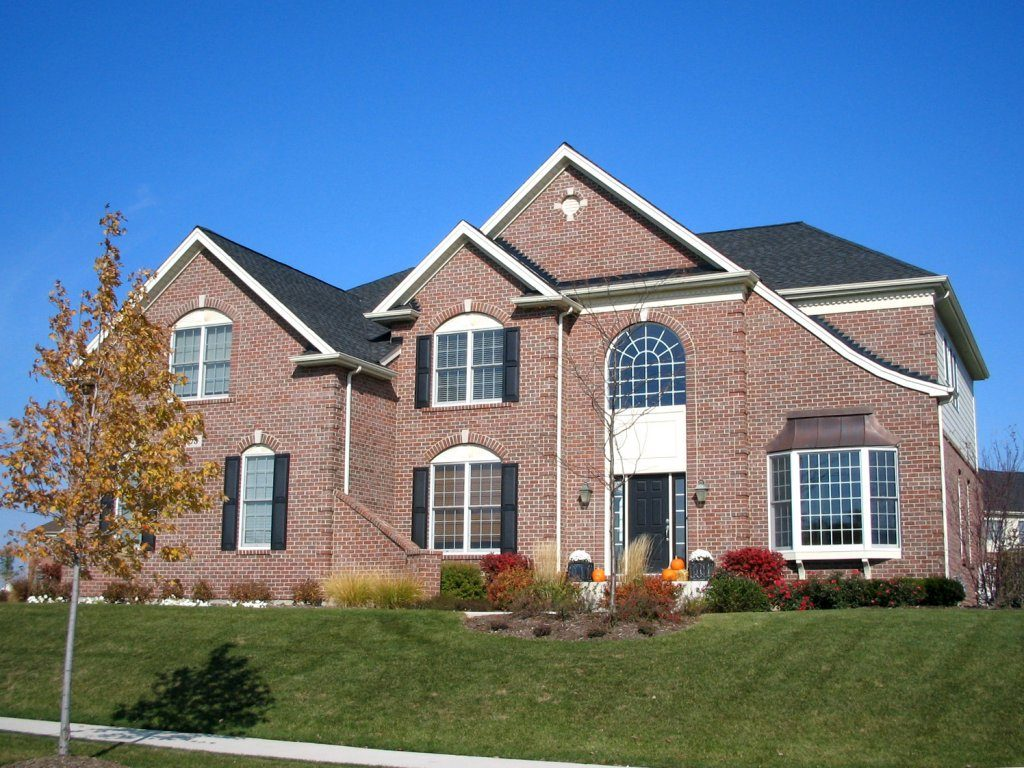 Lovely Harvard Model with 3 car garage in the Hawthorn Woods Country Club